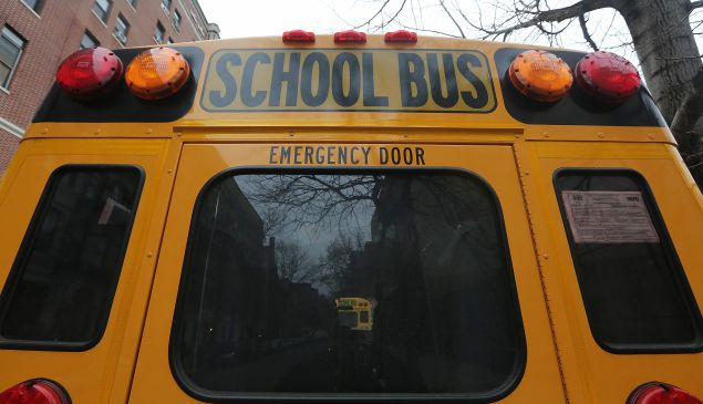 A school buses idles in front of a school in Manhattan's East Village on January 15, 2013 in New York City. (Photo by Mario Tama/Getty Images)