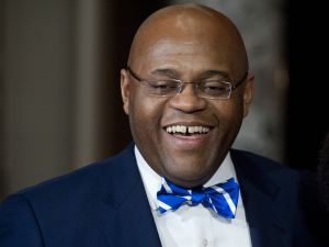 "US Senator William ""Mo"" Cowan smiles after being sworn-in as the new US Democratic Senator from Massachusetts at the US Capitol in Washington, DC, on February 7, 2013."