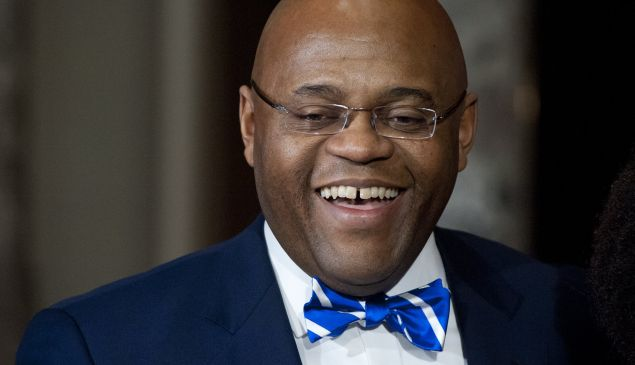 """US Senator William """"Mo"""" Cowan smiles after being sworn-in as the new US Democratic Senator from Massachusetts at the US Capitol in Washington, DC, on February 7, 2013."""