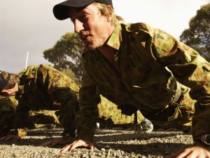 BALLARAT, AUSTRALIA - DECEMBER 4: Clint Bizell does push ups during a commando training session at the Melbourne Demons AFL Football Club pre season training camp at the Pax Scout Camp, Ballarat, Australia on December 4, 2002.