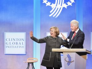 Hillary Clinton and husband, Former U.S. President Bill Clinton address the audience during the Opening Plenary Session: Reimagining Impact for the Clinton Global Initiative on September 22, 2014.