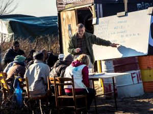 "Migrant children are taught at a makeshift school in the ""Jungle"" camp in the port town of Calais, northern France in February 2016."