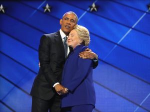 PHILADELPHIA, PA - JULY 27: President Barack Obama and Democratic presidential candidate Hillary Clinton embrace on the third day of the Democratic National Convention