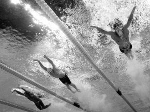 RIO DE JANEIRO, BRAZIL - AUGUST 08: (EDITORS NOTE: This image has been converted to black and white) Michael Phelps of the United States (R) competes in the second Semifinal of the Men's 200m Butterfly on Day 3 of the Rio 2016 Olympic Games at the Olympic Aquatics Stadium on August 8, 2016 in Rio de Janeiro, Brazil.