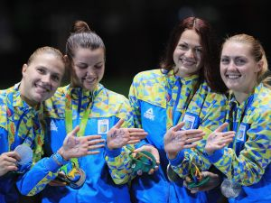 RIO DE JANEIRO, BRAZIL - AUGUST 13: Silver medalists, Alina Komashchuk, Olga Kharlan, Olena Kravatska and Olena Voronina of Ukraine celebrate on the podium during the Women's Sabre Team gold medal match between Russia and Ukraine on Day 8 of the Rio 2016 Olympic Games at Carioca Arena 3 on August 13, 2016 in Rio de Janeiro, Brazil.