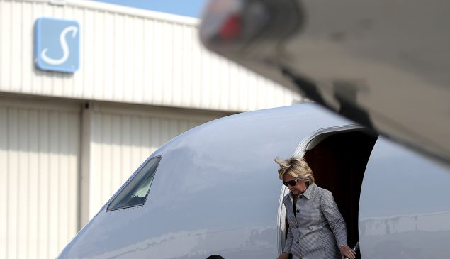 Democratic presidential nominee former Secretary of State Hillary Clinton walks off of her plane at Van Nuys Airport on August 22, 2016 in Van Nuys, California. Hillary Clinton is attending fundraisers in California.