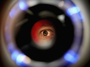 LONDON - OCTOBER 14: A man uses an iris recognition scanner during the Biometrics 2004 exhibition and conference October 14, 2004 in London. The conference will examine the role of new technology such as facial recognition and retinal scans to determine identity to improve security.