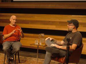Ian MacKaye, left, with Brandon Stosuy, in Kickstarter's Greenpoint auditorium.
