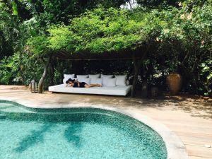 Sarah Lalji by the pool at UXUA Casa Hotel