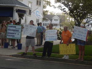 Protestors bearing pro-Trump signs gathered outside a fundraiser hosted at the mayor of Belmar's home last week. Democrats claim they were paid to do it.