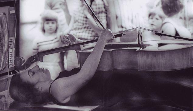 Charlotte Moorman performing Nam June Paik's TV Bed, Bochum Art Week, Bochum, West Germany, 1973.