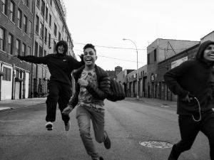 Juan Neira, Chavi Leon, Marco Vasquez and Edwin Amaro running on an afternoon free of school, 10 Apr 2016, Mott Haven, Bronx. All four boys attend different schools but live on the same block.
