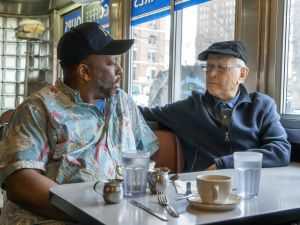 "Rob Robinson, left, with producer Norman Lear in a scene from the documentary, ""America Divided."""