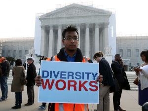 Travis Ballie holds a sign that reads (Diversity Works) in front of the U.S. Supreme Court on October 10, 2012 in Washington, DC.