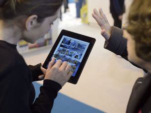 Visitors use an E-Book reader during the 35th edition of the Paris Book Fair.