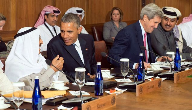 CAMP DAVID, MD - MAY 14: U.S. President Barack Obama talks to Sheikh Sabah Al-Ahmed Al-Jaber Al-Sabah, Amir of the State of Kuwait, while Secretary of State John Kerry talks to Sheikh Tameem Bin Hamad Al-Thani, Amir of the State of Qatar during a working lunch at the Gulf Cooperation Council-U.S. summit on May 14, 2015 at Camp David, Maryland.