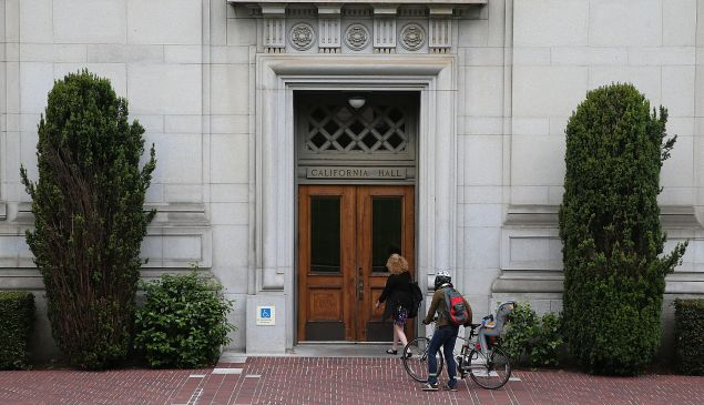 BERKELEY, CA - MAY 22: People enter California Hall on the UC Berkeley campus on May 22, 2014 in Berkeley, California. According to the Academic Ranking of World Universities by China's Shanghai Jiao Tong University, Stanford University ranked second behind Harvard University as the top universities in the world. UC Berkeley ranked third.