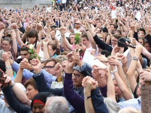 Members of the crowd attending a commemorative event to celebrate the life of murdered Labour MP Jo Cox link hands as a show of unity in Trafalgar Square, central London, on June 22, 2016, on what would have been Jo's 42nd birthday. Murdered British MP Jo Cox's family marked what would have been her 42nd birthday on June 22 with a river tribute and a rally in London on the eve of Britain's European Union referendum. The commemoration in the city's central Trafalgar Square was set to be matched with similar events taking place in cities around the world, among them Beirut, Nairobi, New York and Paris.