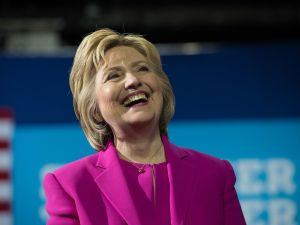 """US Democratic presidential candidate Hillary Clinton laughs as President Barack Obama speaks at a campaign event for in Charlotte, North Carolina, on July 5, 2016. US President Barack Obama threw his full weight behind Hillary Clinton's bid to succeed him, extolling the experience and fighting spirit of his former secretary of state at their first joint campaign appearance. """"I'm here today because I believe in Hillary Clinton,"""" Obama told the rally in Charlotte, North Carolina. """"There has never been any man or woman more qualified for this office."""""""