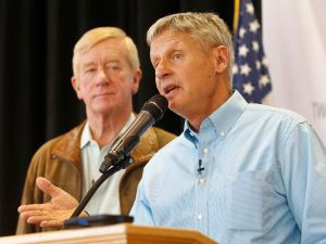 Libertarian presidential candidate Gary Johnson (R) and running mate, Bill Weld (L), talks to a crowd of supporters at a rally on August 6, 2015 in Salt Lake City, Utah.