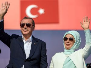 Turkish President Recep Tayyip Erdogan (L) and First Lady Emine Erdogan (R) wave at supporters on August 7, 2016 in Istanbul during a rally against failed military coup on July 15.