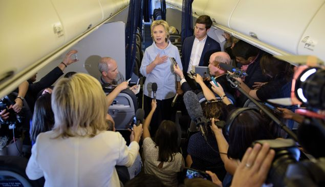 Democratic presidential nominee Hillary Clinton speaks to the press onboard her plane September 5, 2016.