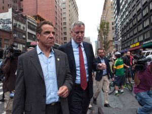 "New York City Mayor Bill de Blasio (R) and New York Gov. Andrew Cuomo tour the site of the bomb blast on 23rd St. in Manhattan's Chelsea neighborhood on September 18, 2016 in New York City. An explosion that injured 29 people which went off in a construction dumpster is being labeled an ""intentional act"". A second device, a pressure cooker, was found four blocks away that an early investigation found was likely also a bomb."