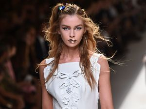 Sparkly lips and hair studs completed the look at Fendi.