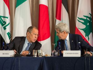 Russian Foreign Minister Sergei Lavrov and United States Secretary of State John Kerry speak during the International Syria Support Group meeting, September 22, 2016 in New York.