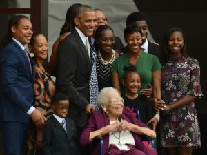 President Barack Obama and four generations of the Bonner family, who are descendants of slaves, stand together to have their picture taken after ringing the First Baptist Church Bell to officially open the Smithsonian's National Museum of African American History and Culture in Washington, DC, September 24, 2016.