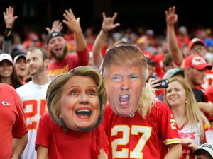 Kansas City Chiefs fans wear Hillary Clinton and Donald Trump masks during the game between the Chiefs and the New York Jets at Arrowhead Stadium on September 25, 2016 in Kansas City, Missouri.