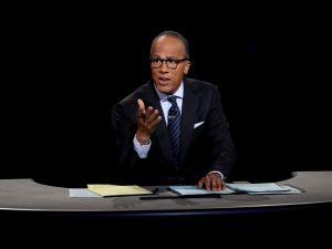 Moderator Lester Holt listens during the Presidential Debate at Hofstra University on September 26, 2016 in Hempstead, New York.