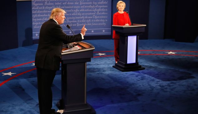 Republican presidential nominee Donald Trump (L) speaks as Democratic presidential nominee Hillary Clinton (R) listens during the Presidential Debate at Hofstra University on September 26, 2016 in Hempstead, New York