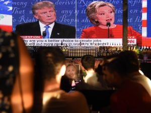 Clinton supporters watch the first US presidential debate between Democratic candidate Hillary Clinton and Republican Donald Trump, at a debate watch party.