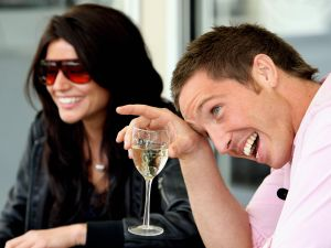 """Paul Bardetta (R) of Sydney, laughs as he talks with his celebrity date and local television host Brooke Sheehan (L), during an online dating promotion by Australia's only live, mobile dating website """"Partner4Real"""", in Sydney, 17 September 2007. Over the next week Bardetta will date 20 women at his portable house on Circular Quay in Sydney, selecting one to take to Paris with him as a prize. AFP PHOTO/Greg WOOD"""