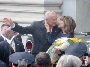 Outgoing Police Commissioner Bill Bratton embraces his wife as he waves goodbye to the crowd on his last day as the city's top cop.