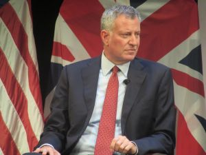 Mayor Bill de Blasio listens during a forum alongside London Mayor Sadiq Khan.