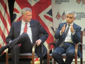 Mayor Bill de Blasio listens as his London counterpart, Sadiq Khan, the city's first Muslim mayor, speaks.