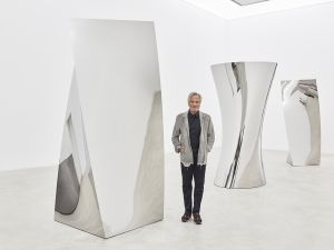 """Anish Kapoor among his sculptures in the """"Gathering Clouds"""" show, currently on at Kukje Gallery."""