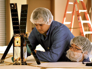 Planetary Society's Lightsail team members Alex Diaz (Left) and Riki Munakata (Right) prepare the solar spacecraft for a deployment test