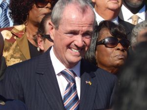Phil Murphy is tacking anti-Wall Street as a primary rival continues to attack his history at Goldman Sachs.