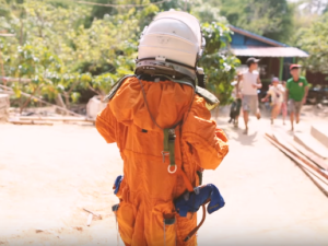 A young girl in Myanmar wears a spacesuit for the first time.