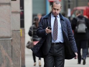 LONDON, ENGLAND - NOVEMBER 07: A man checks his mobile phone on the day that Twitter announced its initial public offering and debut on the New York Stock Exchange on November 7, 2013 in London, England. Twitter went public on the NYSE opening at USD 26 per share, valuing the company's worth at an estimated USD 18 billion. (Photo by Bethany Clarke/Getty Images)