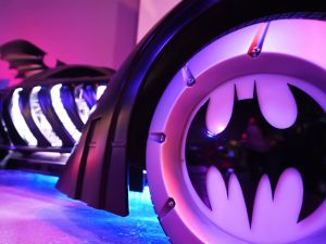 "The Batmobile from ""Batman Forever"" (1995, staring Val Kilmer) is seen at The Batman Exhibit on the exhibitions opening day on the Warner Bros. VIP Studio Tours at the Warner Bros. Studio lot in Burbank, California, on June 26, 2014. The exhibit celebrates the DC Comics iconic super hero and features batmobiles, costumes, props and other items from all seven Batman movies. AFP PHOTO / Robyn Beck (Photo credit should read ROBYN BECK/AFP/Getty Images)"