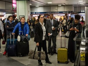 Travellers wait for train information in the Amtrak terminal of New York Penn Station on May 14, 2015 in New York City.