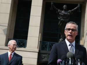 Andrew G. McCabe (R), Assistant Director of the FBI's Washington Field Office speaks while flanked by Dana J. Boente (L), U.S. Attorney for the Eastern District of Virginia, after a hearing in federal court June 11, 2015 in Alexandria, Virginia.