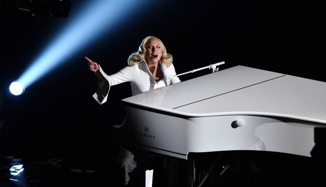 HOLLYWOOD, CA - FEBRUARY 28: Singer-songwriter Lady Gaga performs onstage during the 88th Annual Academy Awards at the Dolby Theatre on February 28, 2016 in Hollywood, California.