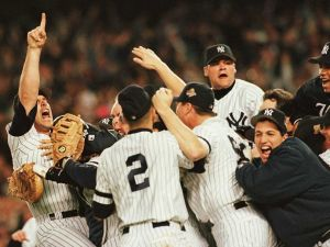 Members of the New York Yankees celebrate on the pitchers mound after beating the Atlanta Braves to win the World Series at Yankee Stadium in New York 26 October.