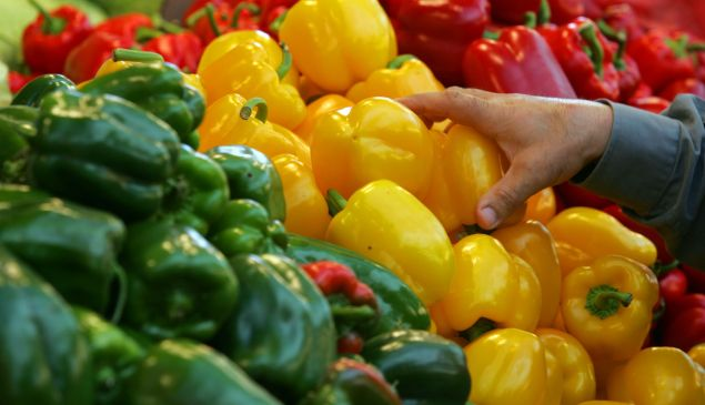 A shopper reaches for a yellow pepper in the local produce market February 22, 2006 in Netanya in central Israel. Fresh locally-grown vegetables, a source of antioxidants according to the American Heart Association, feature regularly in meals in Mediterranean countries.