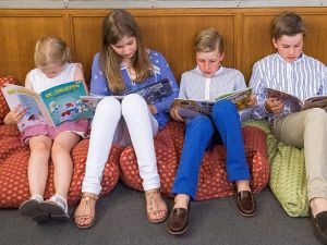 (From L) Princess Eleonore, Crown Princess Elisabeth, Prince Emmanuel and Prince Gabriel read a comic book during a photo-shoot of the Belgian Royal Family's vacation Belgian Comic Strip Center, in Brussels, on July 19, 2016. / AFP / Belga / LAURIE DIEFFEMBACQ / Belgium OUT (Photo credit should read LAURIE DIEFFEMBACQ/AFP/Getty Images)